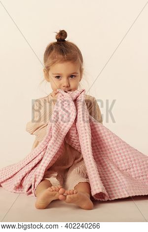 Cute Little Blond Baby Girl Wrapped In Pink Plaid Full Body Portrait