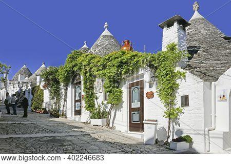 Alberobello, Italy - May 1, 2019: The Traditional Trulli Houses In Alberobello City, Apulia, Italy