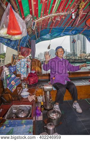 Hongkong, Aberdeen - January 6, 2010: Old Woman Offers Her Boat For Taxi Services In The Harbor Of A