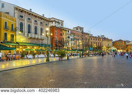 Verona, Italy - August 4, 2009: Piazza Bra In Verona In Sunset With Open Restaurants, Italy