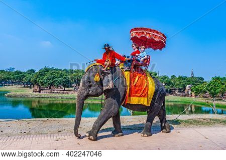 Ayutthaya, Thailand - December 23, 2009:  Tourists Ride On An Elephant In The Historical Park In Ayu