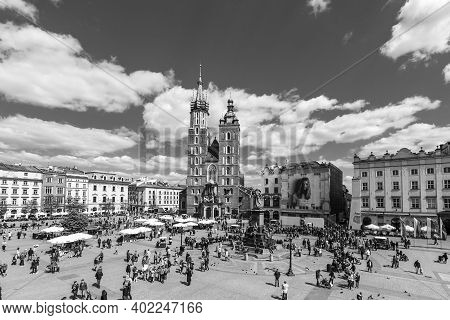 Krakow, Poland - May 5, 2014: Tourists At The Market Square In Krakow . Main Market Square, One Of T