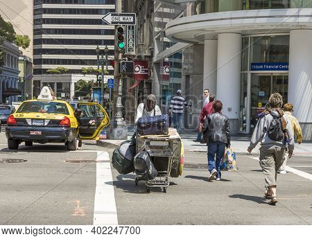 San Francisco, Usa - July 24, 2008: Homeless People Cross The Street At A Pedestrian Crossing With G