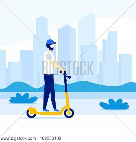 Man Riding Electric Kick Scooter In The City