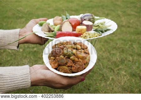 Lady Woman Hand Holding Undhiyu An Authentic Winter Sankrant Food Dish Home Cooked With All The Ingr