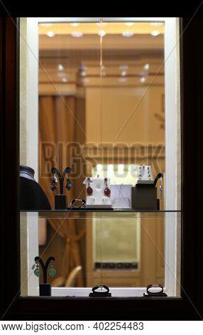Shop window with bijouterie, imitation jewelry accessories. Nihgt light.