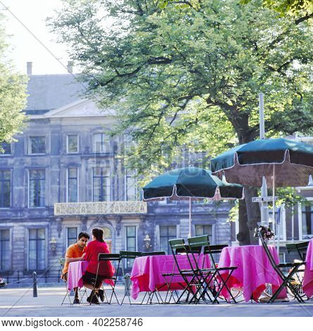 The Hague,holland-august 06 2018: Couple In Love Drink Morning Coffee In Cafe Outdoor On Romantic Da