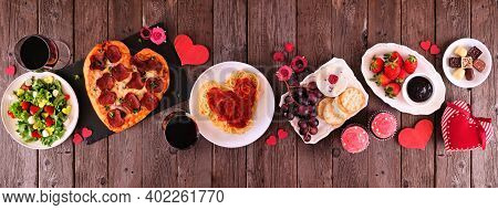 Home Cooked Valentines Day Dinner. Overhead View Table Setting On A Dark Wood Banner Background. Hea