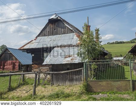 Liptovska Luzna, Low Tatras, Slovakia, August 30, 2020: Old Shabby Log Cabin Cottage, Timbered Rural