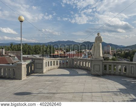 Ruzomberok, Slovakia, August 30, 2020: View Of Ruzomberok Town From City Center With Statue And Gree