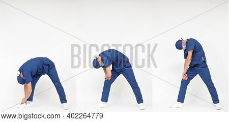 Standing caucasian medical professional in uniform stretching back - profile view