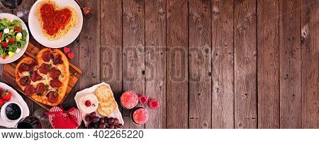 Home Cooked Valentines Day Dinner. Top View Corner Border Against A Dark Wood Banner Background. Hea
