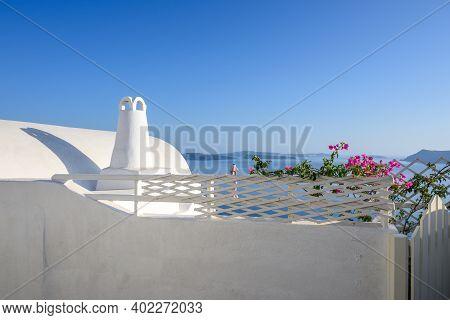 White Cycladic Architecture Of Oia Village On Santorini. Cyclades, Greece
