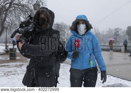 Madrid, Spain - January 07, 2021: A Journalist And A Telemadrid Camera Operator, Working In The Buen