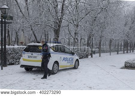 Madrid, Spain - January 07, 2021: A Police Officer Gets Out Of The Local Police Car, In The Buen Ret