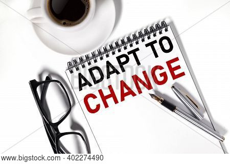 Adapt To Change, Text On Notepad On White Background
