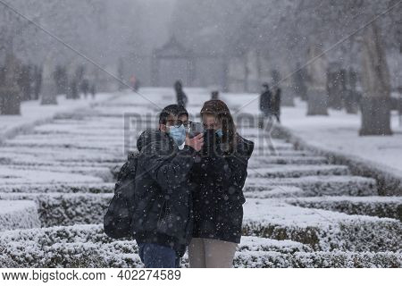 Madrid, Spain - January 07, 2021: A Young Couple Take A Selfie With Their Mobile, In The Buen Retiro