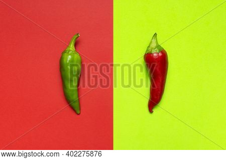 Hot Red And Green Fresh Chili Peppers On Red Green Background Flat Lay Top View. Chili Background. S