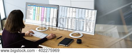 Analyst Employee Working With Spreadsheet On Computer Screen