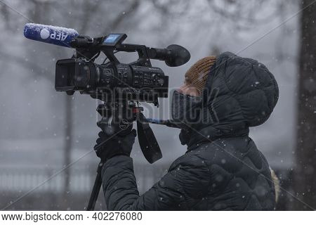 Madrid, Spain - January 07, 2021: A Camera Operator From The Afp Agency, Working In The Buen Retiro