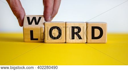 The Word Of The Lord Symbol. Hand Turns The Wooden Cube And Changes The Word 'lord' To 'word' On A B