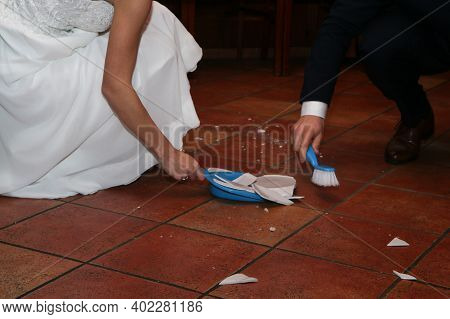 A Traditional Wedding Custom For The Newly Married Couple. The Plate Is Thrown On The Floor And Brok