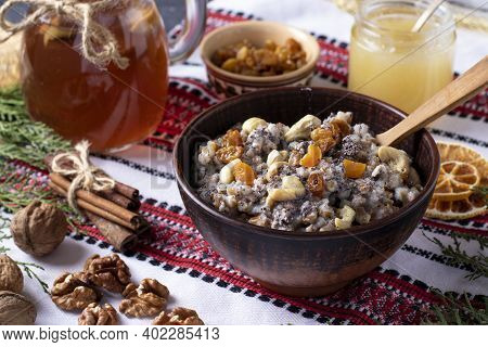 Kutya Is A Ceremonial Grain Dish With Poppy Seeds, Dried Fruits And Sweet Gravy, Traditionally Serve