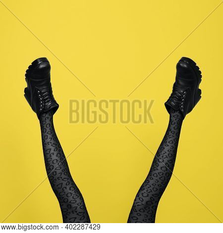 New Gray Female Boots On Long Slender Woman Legs In Gray Tights Isolated On Yellow Background. Pop A