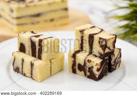 Steamed Marble Chocolate Cheesecake Served In White Plate