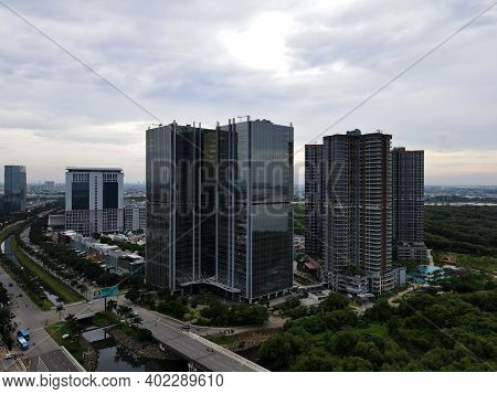 Aerial View Of Office Buildings In Jakarta Central Business District And Noise Cloud When Sunset. Ja