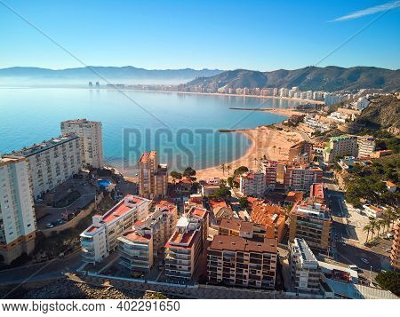 Aerial Drone Point Of View Cullera Sandy Empty Beach And Townscape Rooftops During Sunny Winter Day.