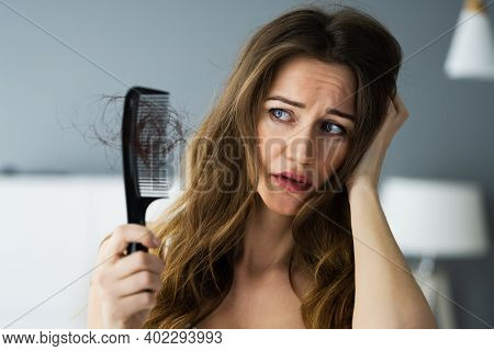 Woman Suffering From Hairloss Or Hairfall Problem