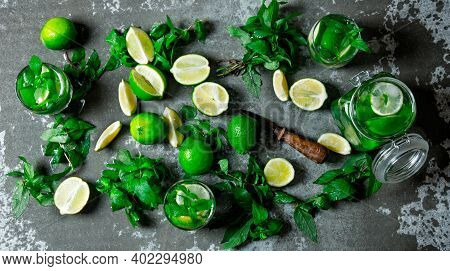 Mojito Cocktail . A Large Table With Ingredients For Making Mojitos - Lime, Mint Leaves, Rum, Sugar