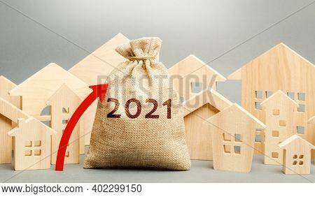2021 Money Bag With Up Arrow And Miniature Houses. Real Estate Planning And Financing Concept. Housi