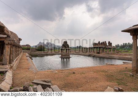 Hampi, Karnataka, India - November 5, 2013: Sri Krishna Tank In Ruins. Low View Of Shrine In Middle