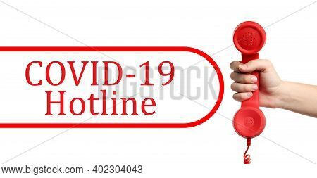 Covid-19 Hotline. Woman With Red Handset And Text On White Background, Closeup