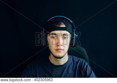 Cyber Sport. Young Handsome Gamer Trying Hard To Win A Round. Streamer And Gamer Concept. The Guy Wi