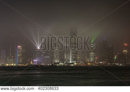 Kowloon, Hongkong - January 6, 2020: Famous Hongkong Laser Show At The Harbor Area With Skyline By N