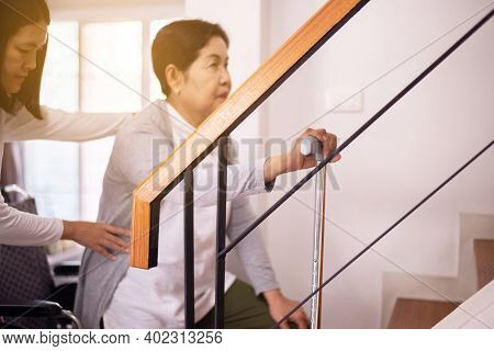 Elderly Woman Hands Holding Sticks While Walking Up Stair At Home,caregiving Take Care And Support,s