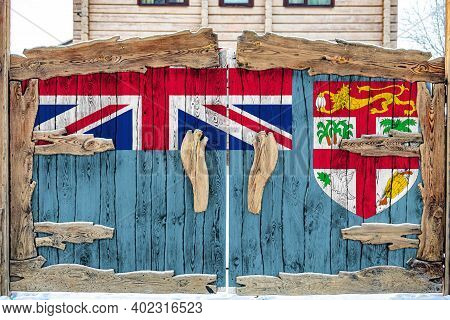 Close-up Of The National Flag Of Fiji On A Wooden Gate At The Entrance To The Closed Territory. The
