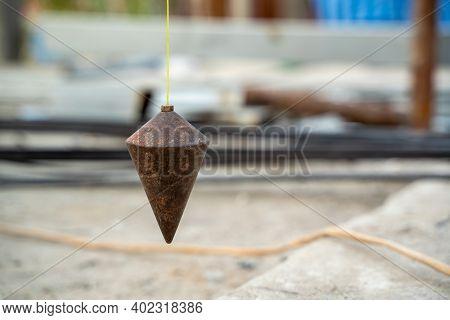 Plumb For Level Measurement At Construction Site.