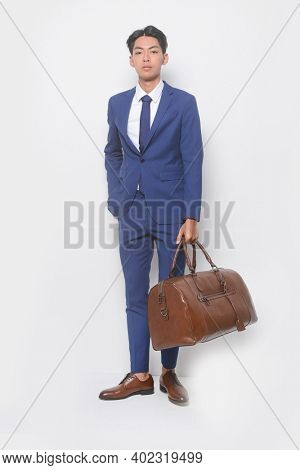 full body young businessman  wearing blue suit ,tie with white shirt and blue pants with brown leather shoes