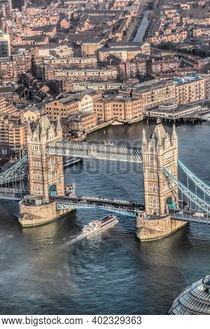 Tower Bridge With Boat On The River In London, England, Uk
