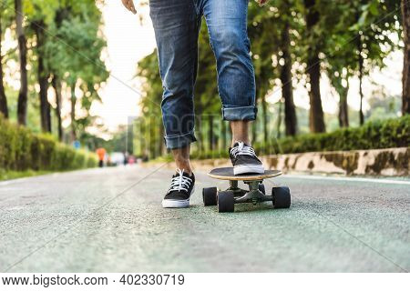 Closeup Asian Man Leg On Surfskate Or Skate Board In Outdoor Park When Sunrise Time Over Photo Blur