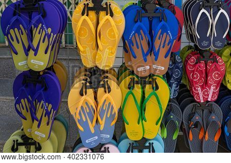 Multicolored Slippers For Sale At The Street Market. Stall With Traditional Tourism Products. Nha Tr