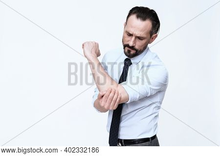 The Man Has A Sore Elbow.