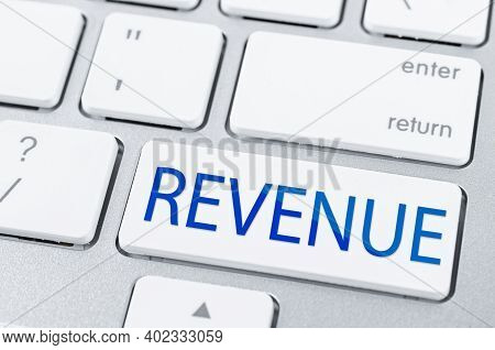 Laptop Computer Keyboard With Revenue Button. Concept Means Continuous Action To Generate Revenue