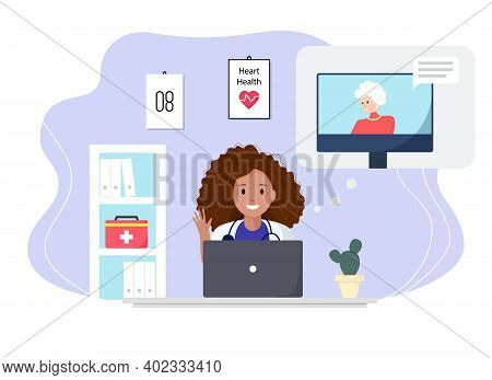 Doctor Consulting A Patient Through Computer In The Cabinet. Senior Woman Consulting A Doctor Online
