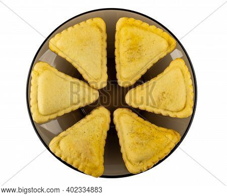 Few Small Savory Pies In Glass Brown Saucer Isolated On White Background. Top View