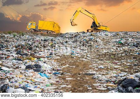 Garbage Dump Pile In Trash Dump Or Landfill,backhoe And Truck Is Dumping The Gabage From Municipal,g